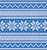 Knitted blue jersey with white pattern Stock Photos