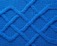 Knitted blue material fragment Stock Photos
