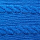 Knitted blue material fragment Royalty Free Stock Image
