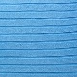 Knitted blue material fragment Royalty Free Stock Images