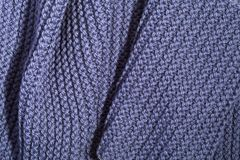 Knitted blue scarf Stock Images