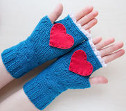 Knitted blue valentine's day fingerless mitts Stock Photography