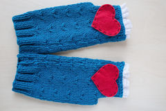 Knitted blue valentine's day fingerless mitts Stock Image