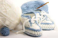 Knitted booties  . Royalty Free Stock Photography