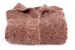 Knitted brown jersey folded Stock Photos
