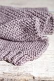 Knitted brown scarf royalty free stock image