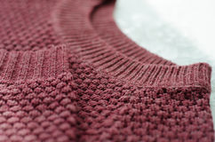 Knitted burgundy sweater on white background Stock Image