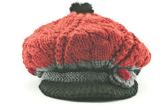 Knitted cap. Warm knitted cap on a white background Stock Photo