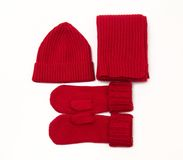 Knitted cap; scarf and gloves. Red knitted cap, scarf and gloves Royalty Free Stock Photos