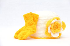 Knitted cap with socks Stock Photos