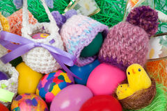 Knitted caps and baskets for Easter Royalty Free Stock Image