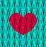 The  knitted card with red heart Royalty Free Stock Image