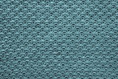 Knitted cellular texture of blue green color Stock Photography