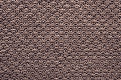 Knitted cellular texture of terracotta brown color Royalty Free Stock Photos