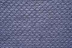 Knitted cellular texture of violet color Stock Image