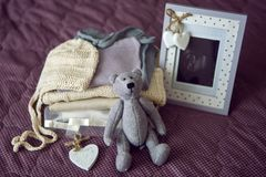 Knitted children`s clothing and ultrasound picture of your child lying on the bed