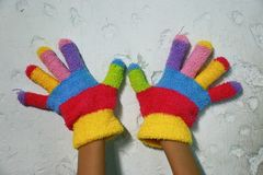 Knitted children's glove with colorful stripes Stock Photo