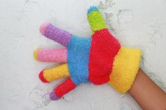 Knitted children's glove with colorful stripes.  Stock Photos