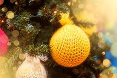 Knitted Christmas ball on  Christmas tree Stock Photo