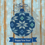 Knitted Christmas ball with snowflakes Royalty Free Stock Images
