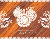 Knitted Christmas balls on the wooden background Royalty Free Stock Image