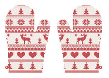 Knitted christmas mittens with pattern Stock Photo