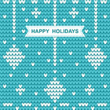 Knitted Christmas pattern with the words happy holidays on blue Stock Image