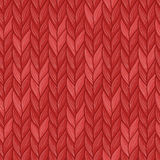 Knitted christmas red seamless pattern Stock Photos