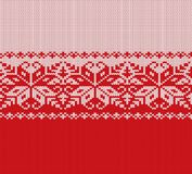 Knitted christmas red and white floral geometric ornament. Xmas knit winter sweater texture design. Vector illustration Stock Images
