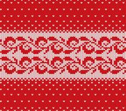 Knitted christmas red and white floral seamless ornament with falling snow. Xmas knit winter sweater texture design. Vector illustration stock illustration