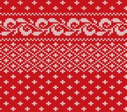 Knitted christmas red and white floral seamless ornament. Xmas knit winter sweater texture design. Vector illustration Stock Photography