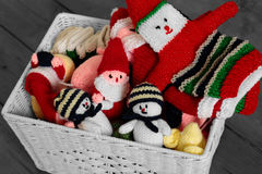 Knitted christmas toys and decorations in a basket Stock Photography