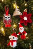 Knitted christmas tree decorations Stock Photos