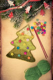 Knitted Christmas tree on paper Royalty Free Stock Images