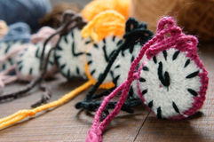 Knitted clock, colorful watch, handmade hobby royalty free stock images