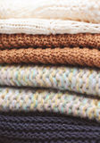 Knitted clothes closeup. Stack of knitted clothes close up, selective focus Stock Photography