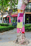 Knitted clothes on trees decorate street in Bellaria Igea Marina, Rimini Royalty Free Stock Photo