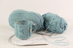 Knitted coat for mug and clews turquoise Stock Images