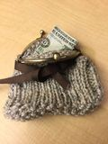 Knitted Coin Purse With Brown Ribbon and Brass Toggle Snap Closure Royalty Free Stock Image