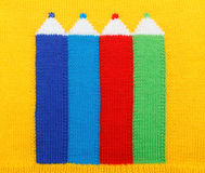 Knitted colored pencils Royalty Free Stock Photos