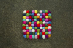 Knitted colorful cubes on the backgrounds Royalty Free Stock Photos