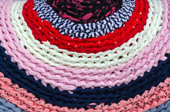 Knitted colorful rustic rug Royalty Free Stock Photos