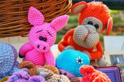 Knitted colorful toys of different animals in a street souvenir shop royalty free stock images
