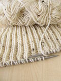 Knitted in cream white Stock Image
