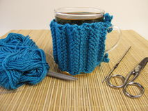 Knitted cup cozy Stock Photo