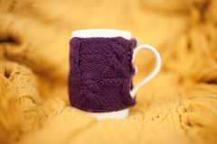 Knitted cup Royalty Free Stock Images