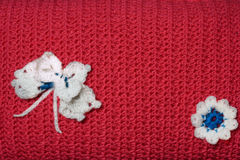 Knitted cushion with butterfly and flower Stock Photo