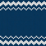 Knitted dark blue Christmas pattern with geometric ornament Stock Images