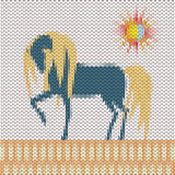 Knitted deep blue cartoon horse and sun in the field Stock Image