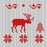 Knitted deer, red-white retro style. Winter forest snowflakes an royalty free illustration